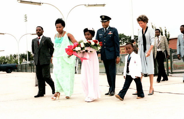 BGEN Archer Durham escorts the party of President Juvenal Habyarimana of Rwanda, upon their arrival for a visit