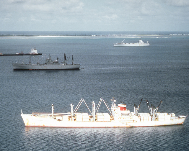 A port beam view of the cargo ship AMERICAN COURIER (T-AK-0107) at anchor off Diego Garcia. The AMERICAN COURIER is under charter to the Military Sealift Command