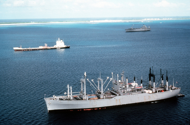 A port view of the vehicle cargo ship USNS METEOR (T-AKR-9), with the Military Sealift Command charter transport oiler ZAPATA PATRIOT (T-AOT-1001) in the background