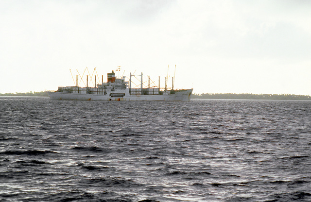 A starboard view of the cargo ship AMERICAN CHAMPION (T-AK-2011) of Diego Garcia. The AMERICAN CHAMPION is under charter to the Military Sealift Command