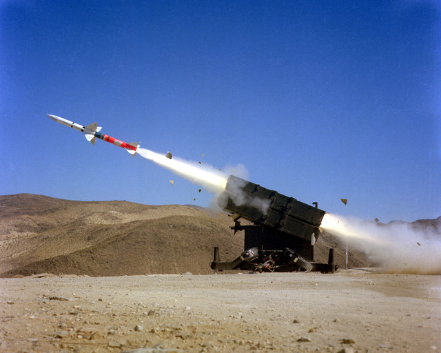 A left side view of an AIM-7F Sparrow III air-to-air missile being launched from a Skyguard missile launcher
