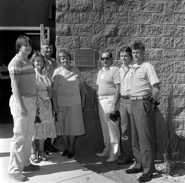 Brigadier General Harold G. Glasgow, First Lieutenant Sparks, and the family of Second Lieutenant Richard J. Matteson stand in front of the plaque mounted on the new counter intelligence (CIT) building at the Marine Corps Air-Ground Combat Center. The building was named in the memory of Matteson who died in the fire that destroyed the old CIT building