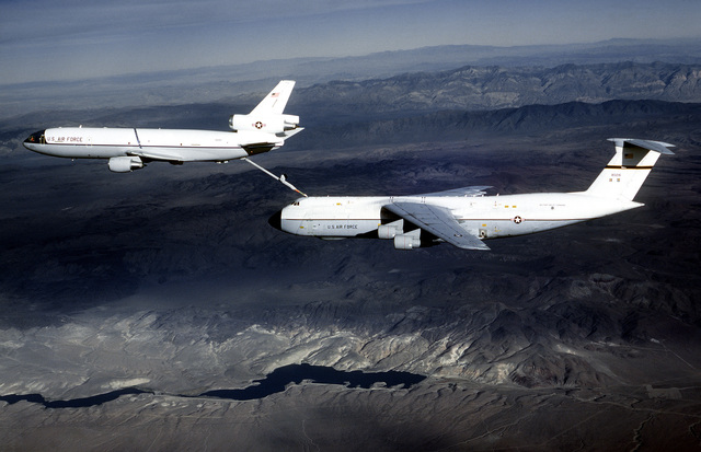 AN air-to-air left side view of a KC-10 Extender aircraft refueling a C-5 Galaxy aircraft