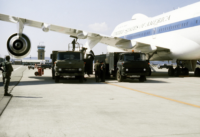 AN E-4B aircraft is refueled on the flight line