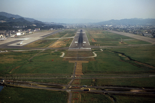 An elevated view of the runway approach to the airport