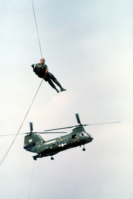 Two Marine officer candidates from The Basic School rappel from CH-46 Sea Knight helicopters as part of their training