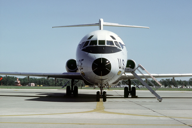 A front view of a 375th Aeromedical Airlift Wing C-9 Nightingale aircraft on the flight line with staircase in position