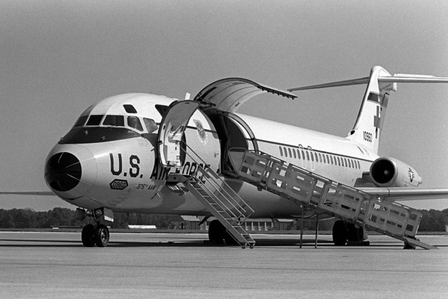 A left front view of a 375th Aeromedical Airlift Wing C-9 Nightingale aircraft on the flight line with staircase and loading ramp in position