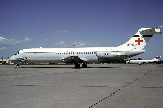 A left side view of a 375th Aeromedical Airlift Wing C-9 Nightingale aircraft on the flight line with staircase in position