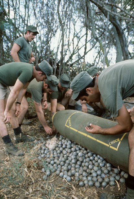 Combat control team (CCT) members familiarize themselves with one of the different types of bomblets