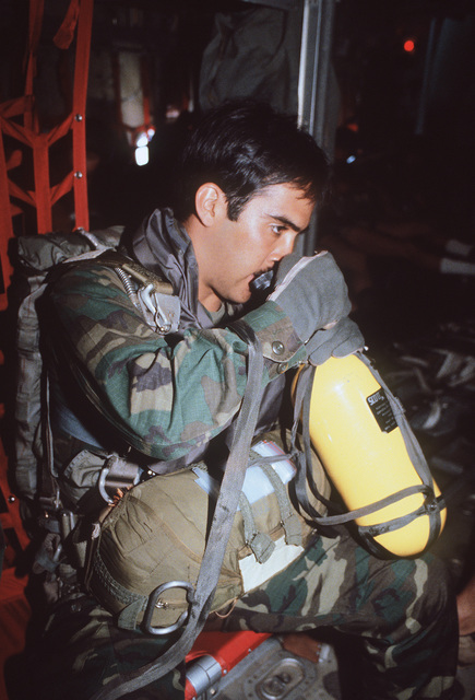 SRA Morales of the combat control team breathes oxygen before his high-altitude, low-opening (HALO) jump