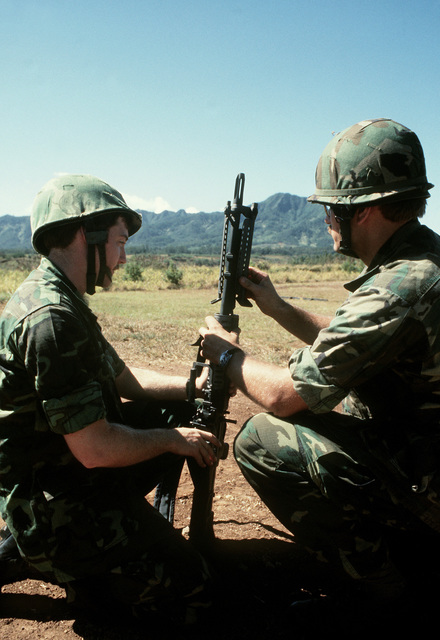 SSGT Miller and SGT Lindland, members of the combat control team (CCT), set up the M-60 machine gun