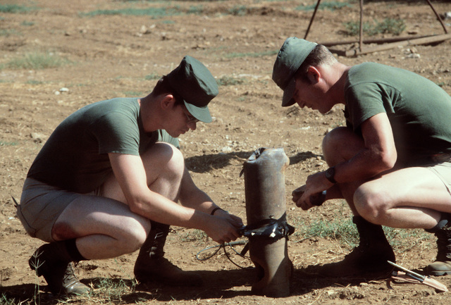 SSGT Tynan and MSGT Williams prepare the charge on the bomb for the combat control team (CCT)