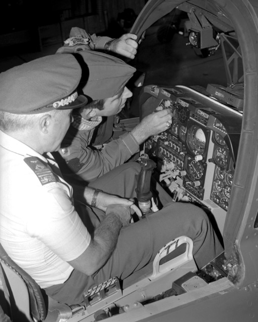 A U.S. Air Force pilot briefs Italian air force GEN Basilio Cottone, commander, 5th Allied Tactical Air Force, NATO, on an aircraft instrument panel