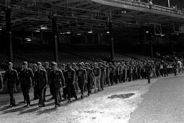 GUNNERY Sergeant Sparks drills the John Brooks Platoon (Delayed Enlistment Program) at Tiger Stadium to help prepare them for basic training