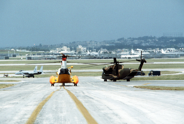 A view of an H-46 helicopter, an HH-53 Super Jolly helicopter and an F-15 Eagle aircraft during Operation Cope Angel