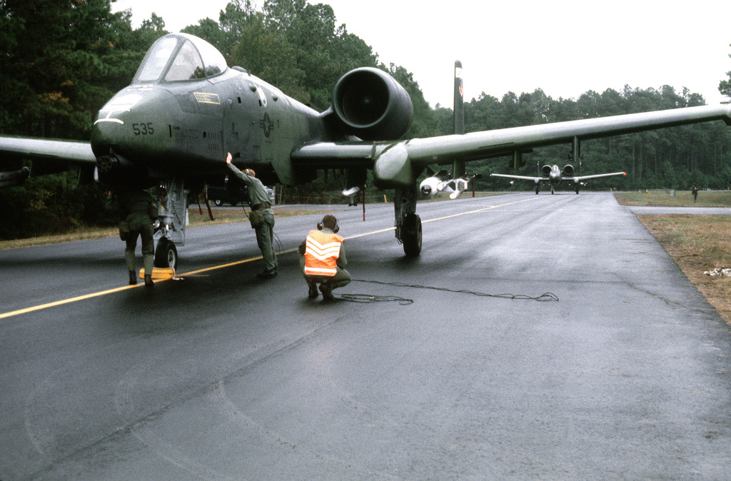 An A-10 Thunderbolt II aircraft undergoes preflight check during exercise Thunderhog II '80