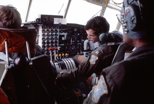 Members of the 33rd Aerospace Rescue and Recovery Squadron, in the cockpit of an HC-130 Hercules aircraft, assist in the search for targets previously dropped about 80 miles off the coast of Okinawa, Japan. The men and aircraft are involved in Operation Cope Angel