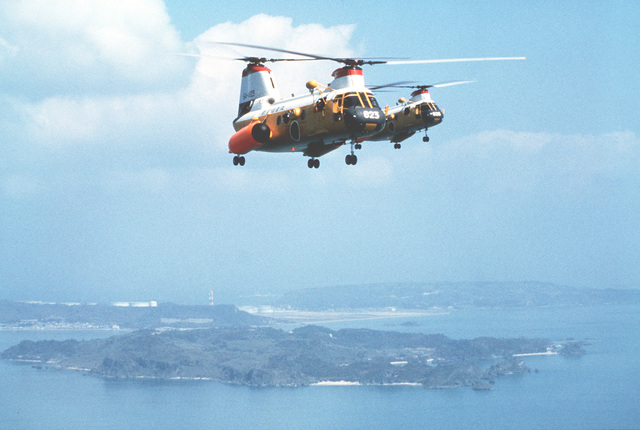 Right side view of two H-46 helicopters from the Japanese Air Self Defense Force in flight during Operation Cope Angel