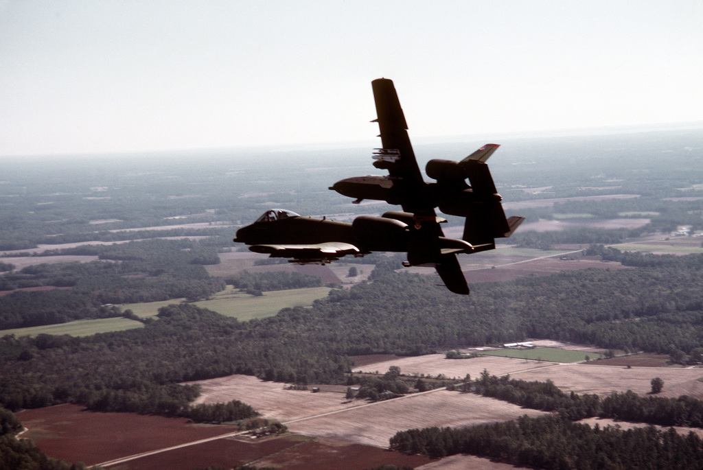 Two A-10 Thunderbolt II aircraft fly in formation during exercise Thunderhog II '80