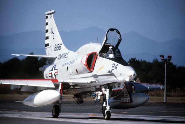 A right front view of an A-4EJ Skyhawk aircraft taxiing out on the runway during exercise Cope North '80. The aircraft is assigned to Marine Light Attack Squadron 214 (VMA-214)