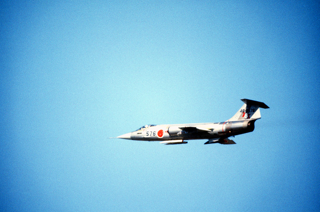 AN air-to-air left side view of Japanese Air Self Defense Force F-104 Starfighter aircraft during Exercise Cope North '80