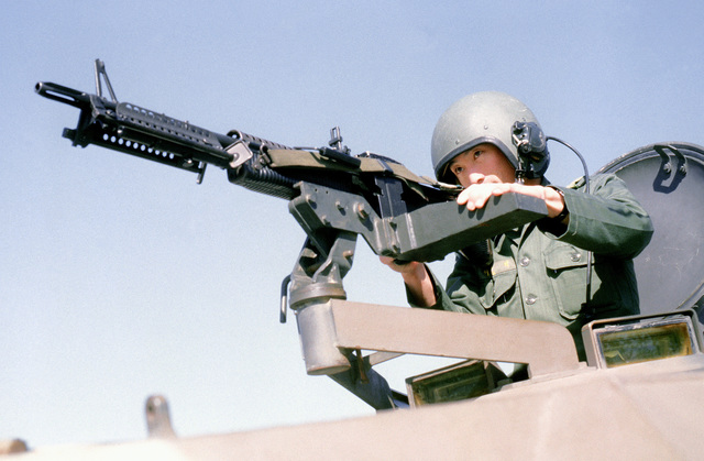 Korean 1LT Lee Young Nam operates an M-60 machine gun on an armored personnel carrier (APC)