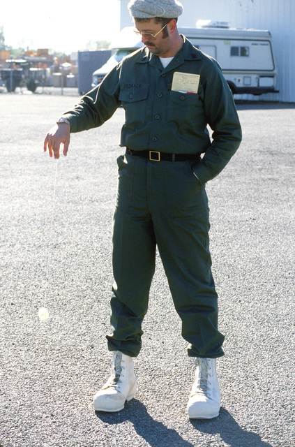 Navy CHIEF Frank Pedraza waits to board a C-141 Starlifter aircraft for the trip to McMurdo Station, Antarctica, during Operation Deep Freeze '80