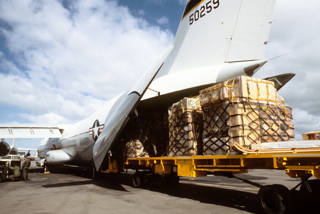 Pallets of cargo are being loaded aboard a C-141 Starlifter aircraft of the 60th Military Airlift Wing for the trip to McMurdo Station, Antarctica, during Operation Deep Freeze '80