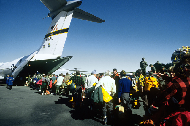 Passengers embark a C-141 Starlifter aircraft of the 60th Military Airlift Wing for the trip to McMurdo Station, Antarctica, during Operation Deep Freeze '80