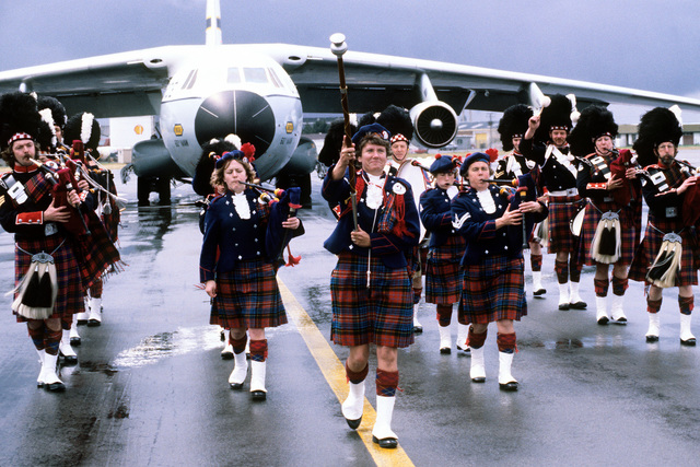 The Christchurch Combined Metropolitan Band marches in front of a C-141 Starlifter aircraft preparing to depart for McMurdo Station, Antarctica, during Operation Deep Freeze '80