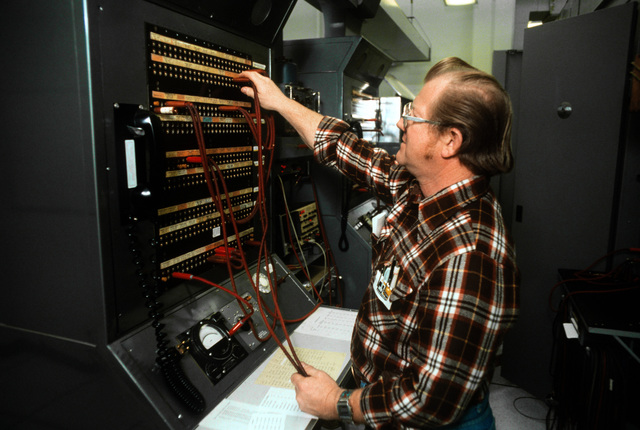 A civilian assigned to the 1965th Communications Squadron, Air Force Communications Command (AFCC), repairs a switchboard