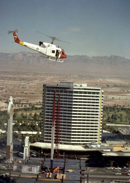 A UH-1N Iroquois helicopter approaches the MGM Grand Hotel as firefighters attempt to control a fire in the hotel