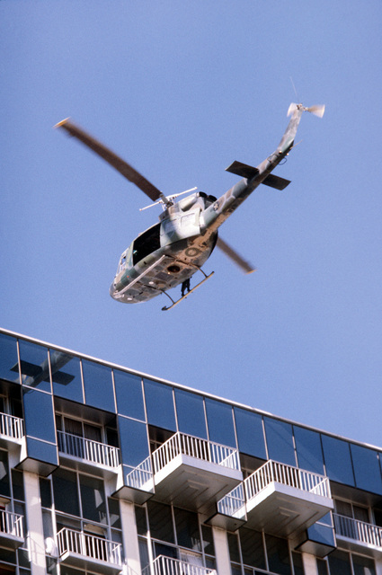 A UH-1N Iroquois helicopter approaches the MGM Grand Hotel during firefighting operations