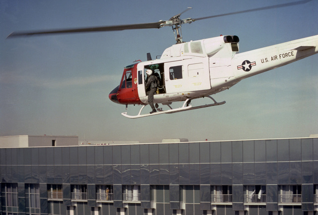 A UH-1N Iroquois helicopter comes in for a landing on the roof of the MGM Grand Hotel during a fire rescue operation