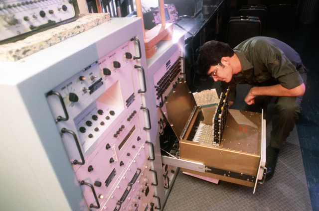 A1C Martin Quarrington from the 2048th Communications Squadron, works on a bench test mock-up of the Base Intrusion Security Systems (BISS) by checking a decoder sensor data board