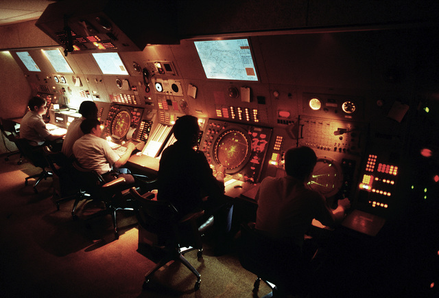 Air traffic controllers at work in the Radar Approach Control (RAPCON) Section of the 1974th Communications Command (AFCC)