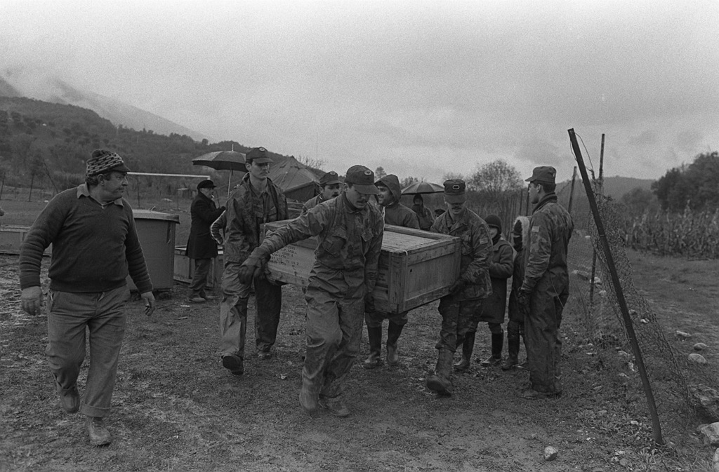 AN Army relief team carries an Army tent in a box to a waiting truck following a major earthquake on November 23. Members of the relief team are: SPEC. 4 Martin O'Connor, right; SPEC. 4 Danio Bartl, left; PVT. David Stone, front; SPEC. 6 Ron Davis, rear; and PFC. Oscar Santiago, far right. The men are from the 1ST Battalion, 509th Infantry Regiment, Vicenza