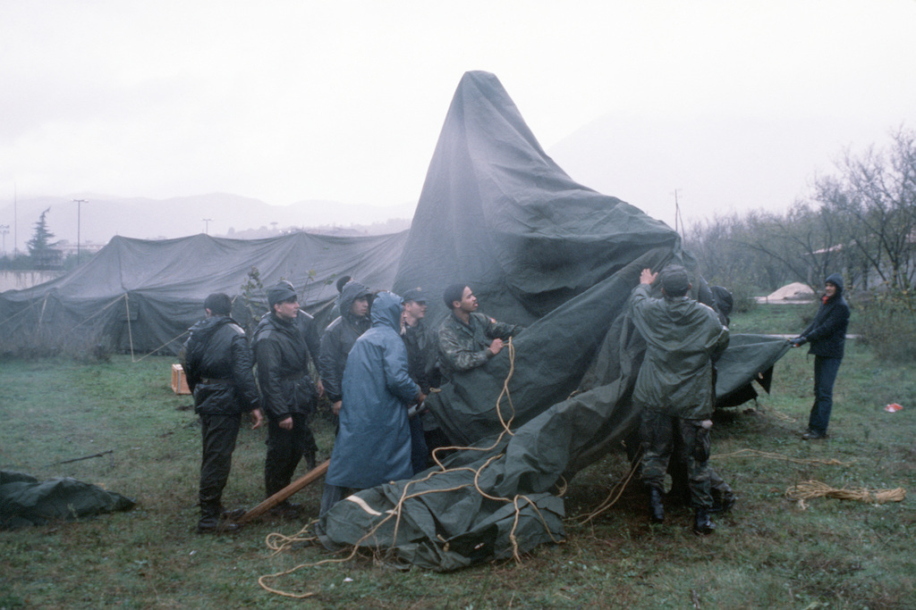 Army paratroopers from 1ST Battalion, 509th Infantry Regiment Vicenza, help set up tents near the soccer stadium after a major earthquake on November 23. The tents were airlifted into Naples from Ramstein Air Base, Germany