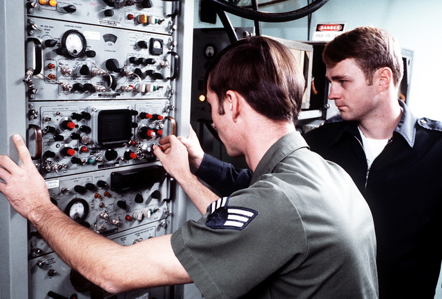 CPT Dale Meyerrose, chief of maintenance, watches as SRA Glenn King, navigational aids maintenance specialist, adjusts the tactical air navigation (TACAN) equipment at the 1974th Communications Group, Air Force Communications Command (AFCC)