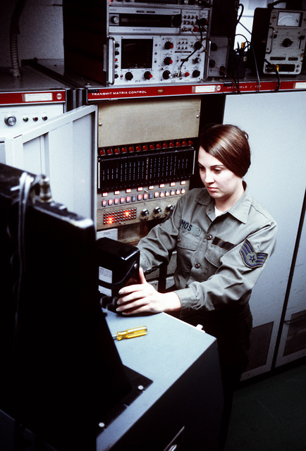 SSGT Ellea Amos, ground radio equipment repair technician, checks the operation of the scope control in the Aeronautical Station of the 1974th Communications Group, Air Force Communications Command