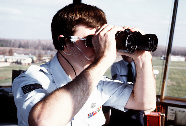 SSGT James B. Ziegler, an air traffic controller with the Air Force Communications Command (AFCC), looks through binoculars