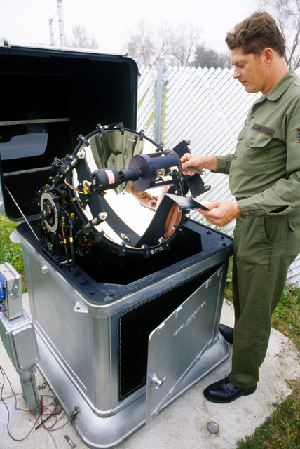 SSGT John W. Owens, 1965th Communications Squadron, Air Force Communications Command (AFCC), prepares to change a bulb in a cloud height detector transmitter