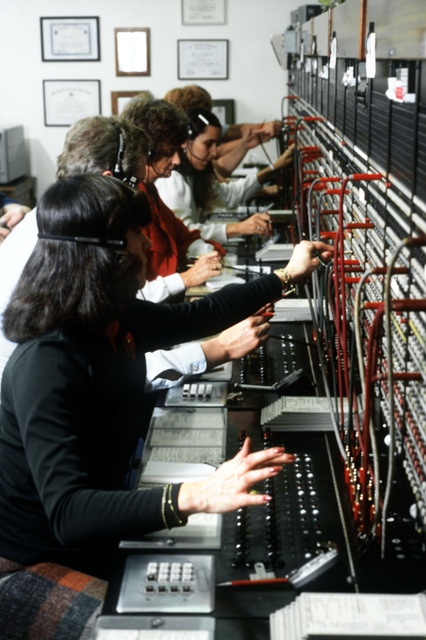 Switchboard operators assigned to the 1965th Communications Squadron, Air Force Communications Command (AFCC), at work