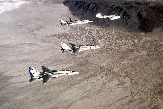 Four F-14 Tomcat aircraft from Fighter Squadron 213 (VF-213) are refueled from a KA-6 Intruder aircraft in-flight near NAS Fallon, Nevada