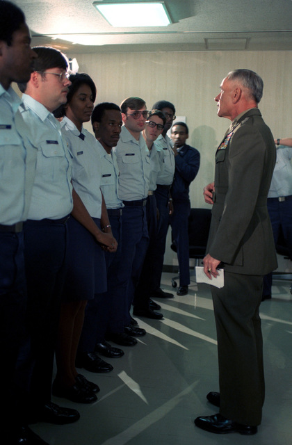 Lieutenant General Edward Bronars informally speaks to the assembled USAF Hospital, Yokota personnel. The hospital was presented the Meritorious Unit Commendation Award for the support given to the Marines burned in a fuel fire at Camp Fuji and subsequently airlifted to Brooks Army Burn Center in Texas
