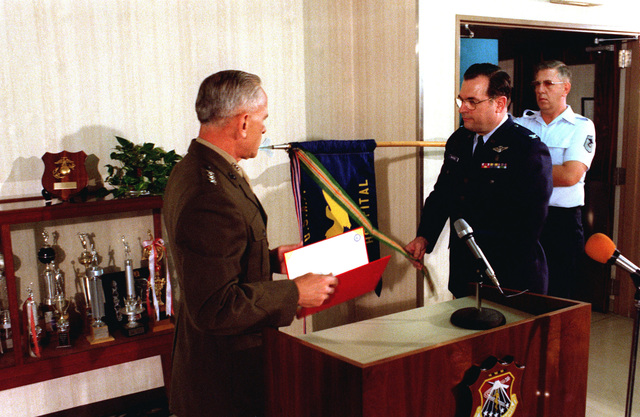 Lieutenant General Edward Bronars, left, presents the Meritorious Unit Commendation Award to Colonel Clarence Whiteside, Commander USAF Hospital, Yokota. The hospital is being presented the award for the support given from 19-22 November, 1979, to the Marines burned in a fuel fire at Camp Fuji and subsequently airlifted to Brooks Army Burn Center in Texas