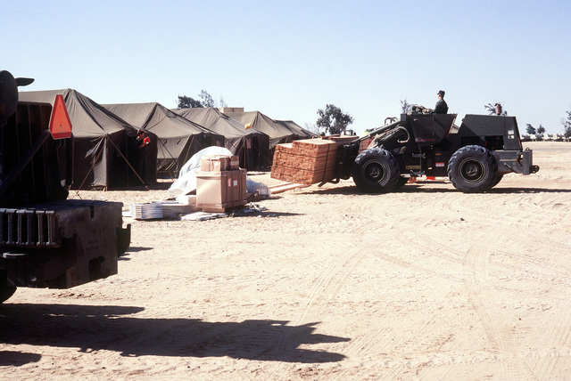 4449th Mobility Support Squadron members unload 2x4's to use in building the base during exercise BRIGHT STAR '80
