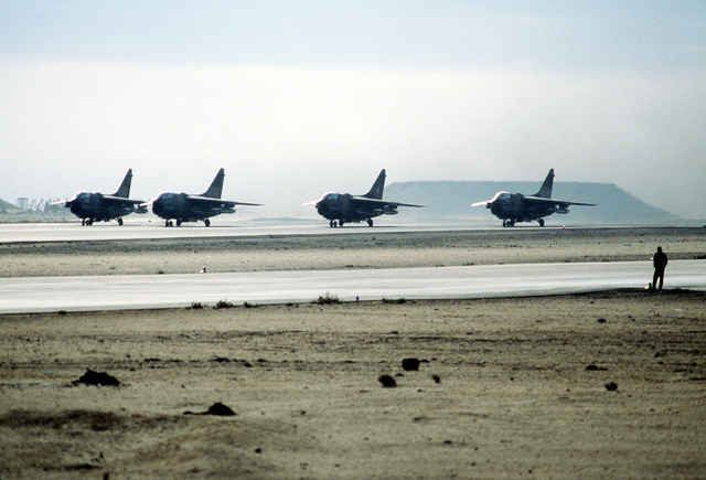A left front view of four A-7 Corsair II aircraft preparing for take-off at the conclusion of exercise Bright Star '80
