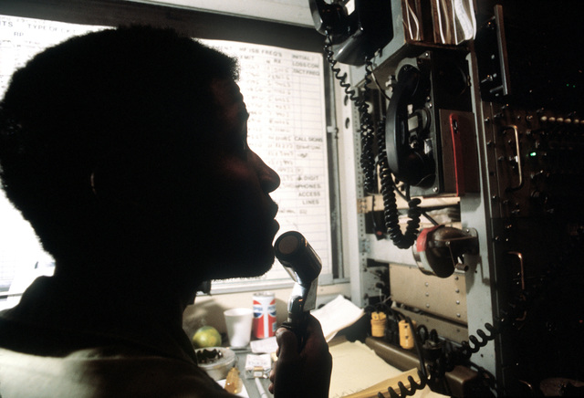 A1C Elascor Pack, 3rd Combat Communications Group, Tinker Air Force Base, Oklahoma, receives a trouble call in the technical control van during exercise Bright Star '80